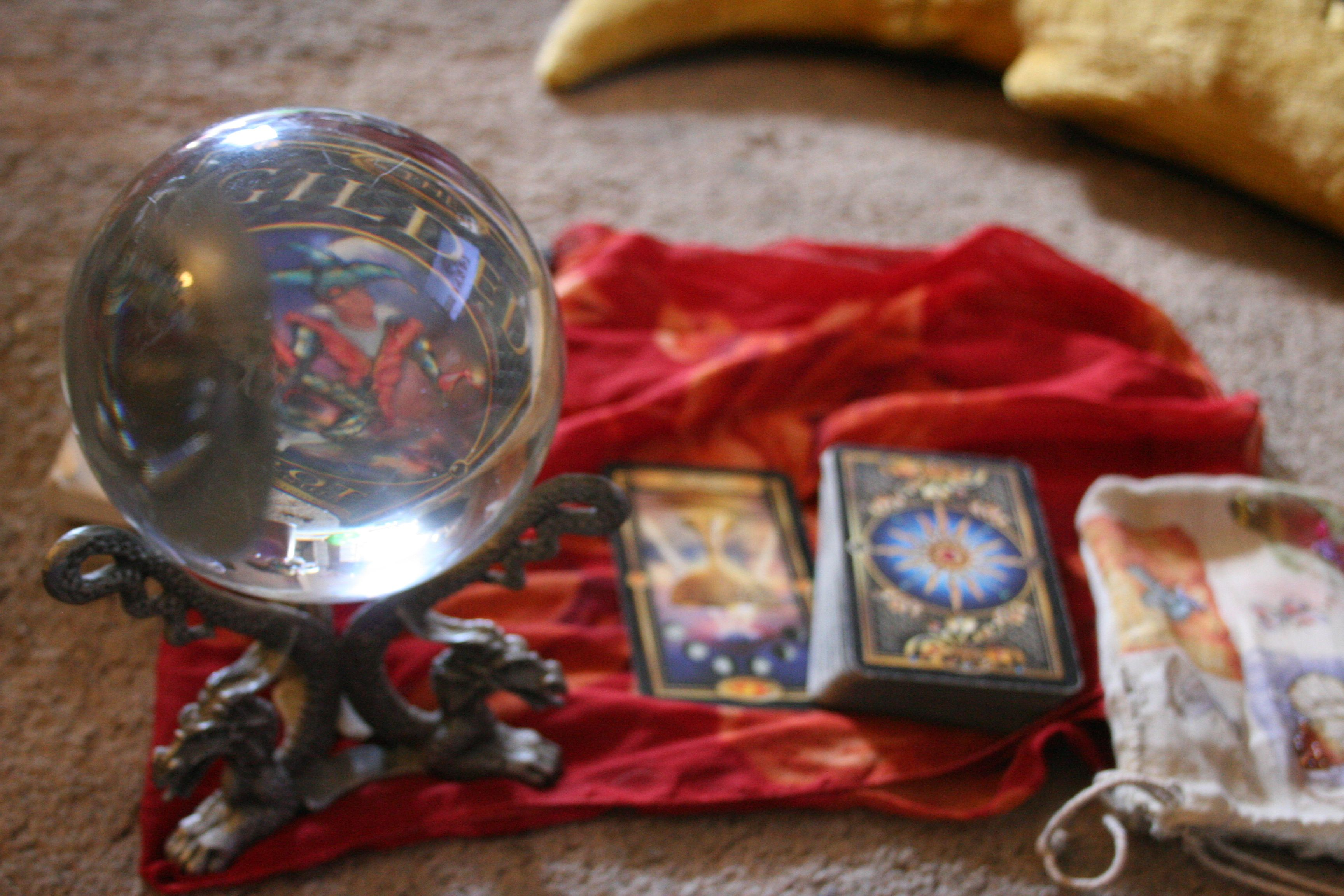 Free tarot card with crystal ball images what might you