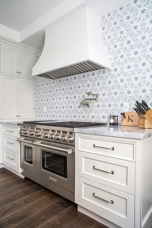 ... Shaker Cabinets Paired With Marble Countertops And A Gray Flower Mosaic  Tiled Backsplash, Walker Zanger Villa Du0027oro Collection Granada Decorative  Field ...