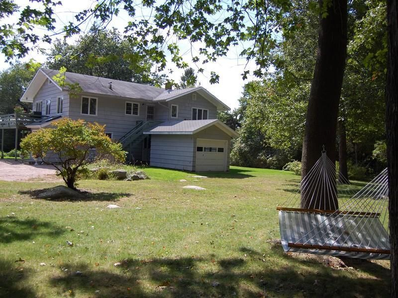 Wonderful vacation or year-round home on a large private lot and peaceful street. Newly updated bathrooms and freshly painted throughout. Ready for a fun family to enjoy everything WEKAPAUG has to offer- Tennis, sailing, croquet,and two private beaches. Great rental history as well.