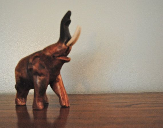Did you know elephants with upturned trunks bring good luck? Check out this hand carved piece on Etsy