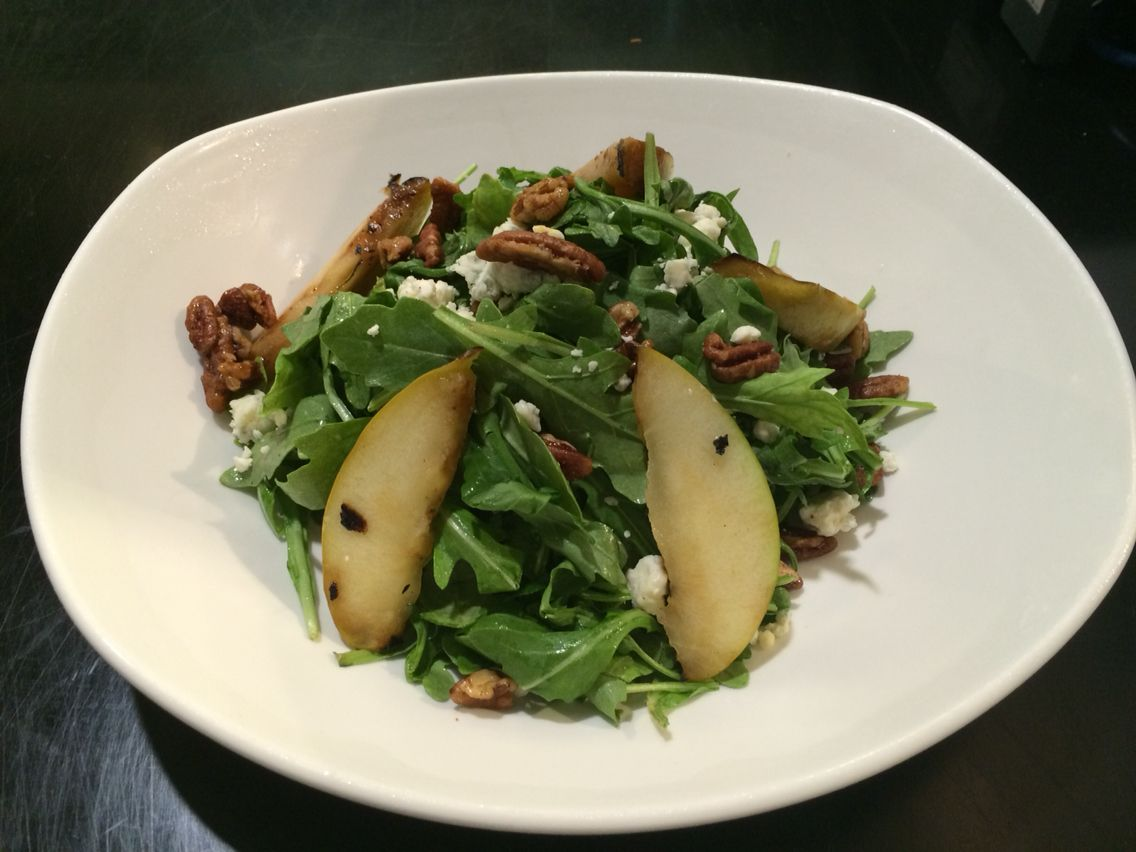 Arugula salad with blue cheese grilled apples and candied pecans