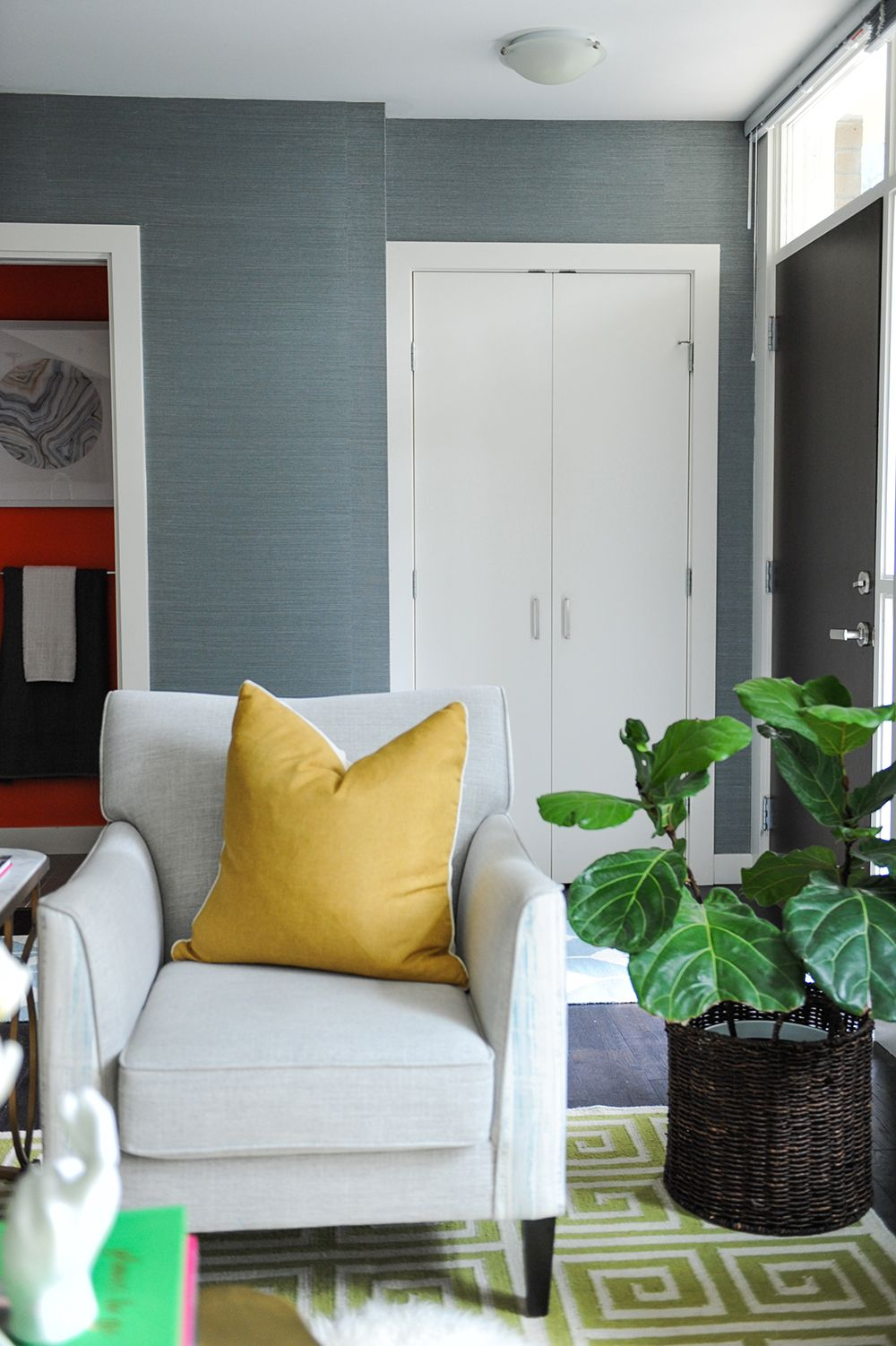 Handsome blue grasscloth paper in an entryway Comfy