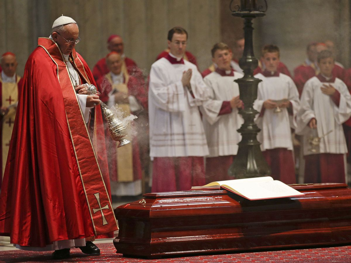 Pope Francis swings a censer over the casket of Italian