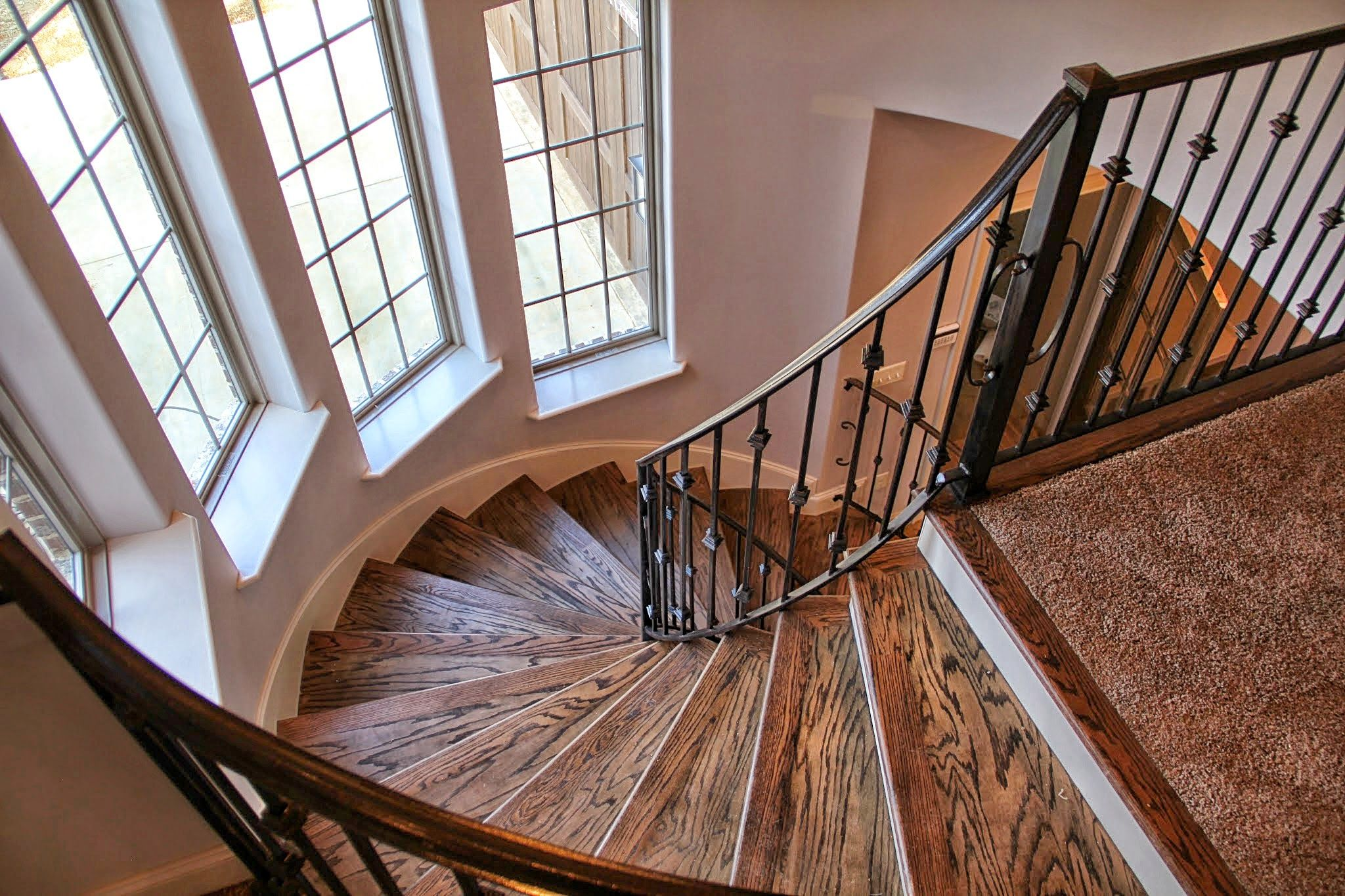 Turret Staircase With Hardwood And Iron Railings Photo Gallery -