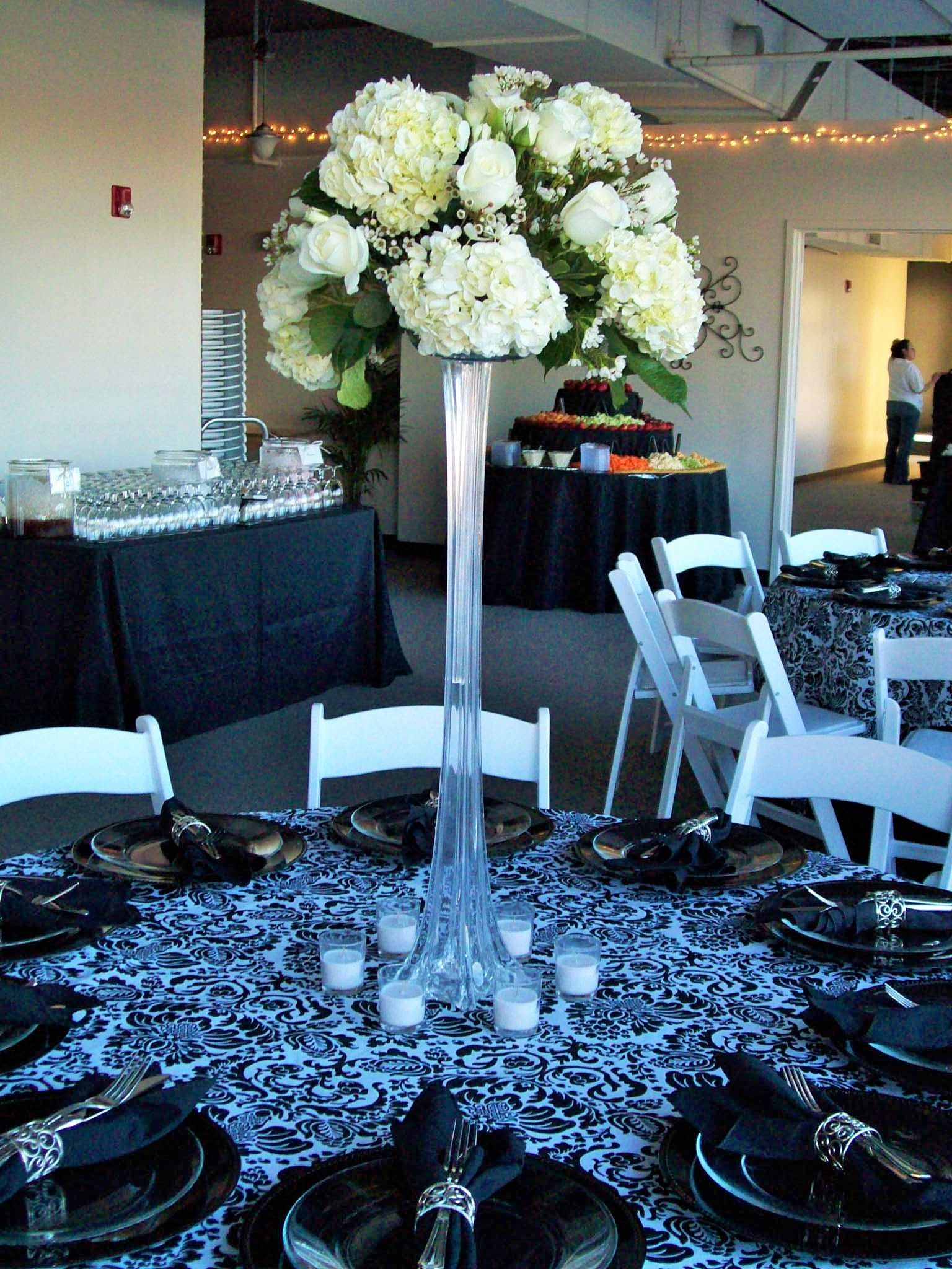 Tall Glass Vase Wedding Centerpiece with White Hydrangeas surrounded