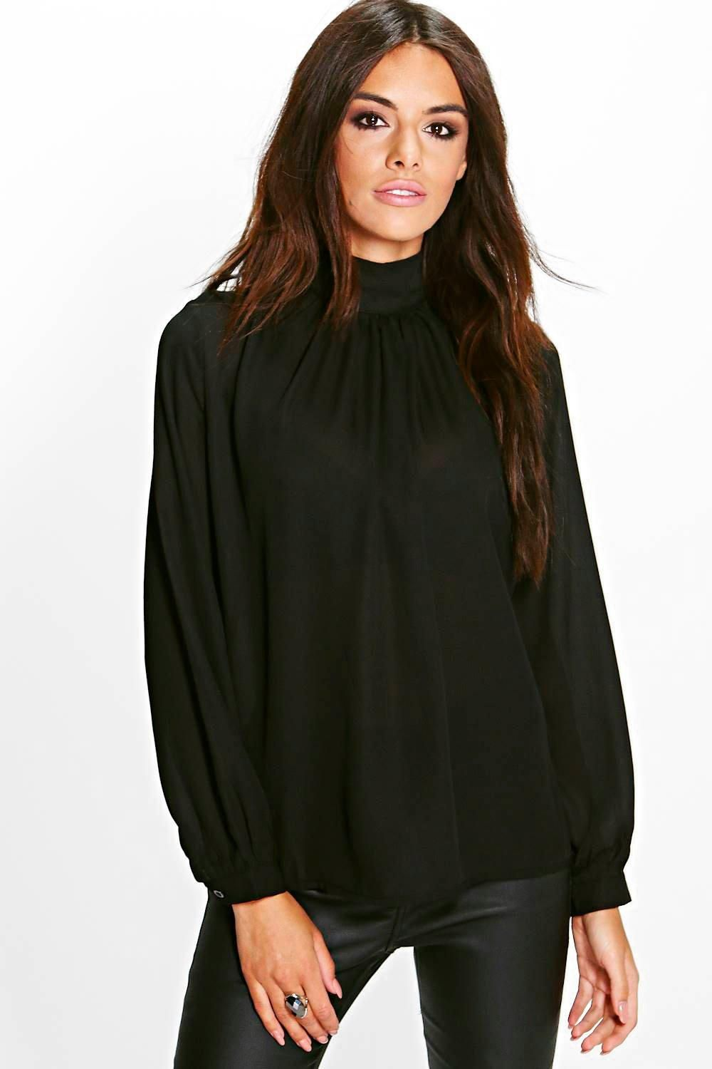 8dcefd16db Click here to find out about the Emma Funnel Neck Woven Blouse from Boohoo