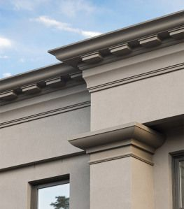 Parapet mouldings with corbels on this beautiful home in for Finishing touch mouldings