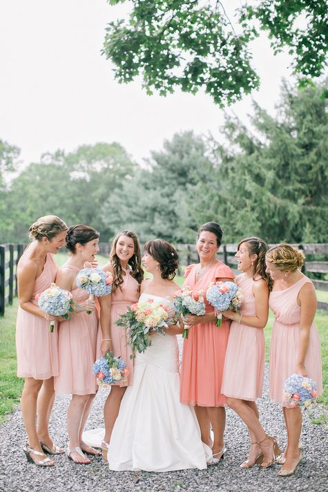Beautiful blush bridesmaid dresses with blue bouquets | Emily Wren Photography | TheKnot.com