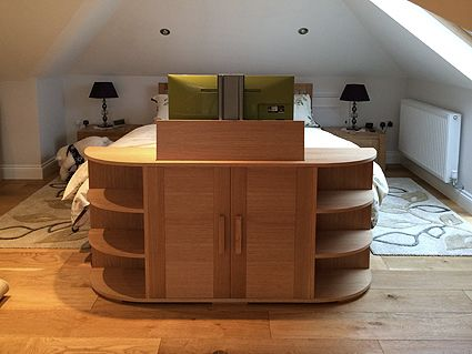 Oak end of bed TV cabinet with TV fully extended | Home Decor ...