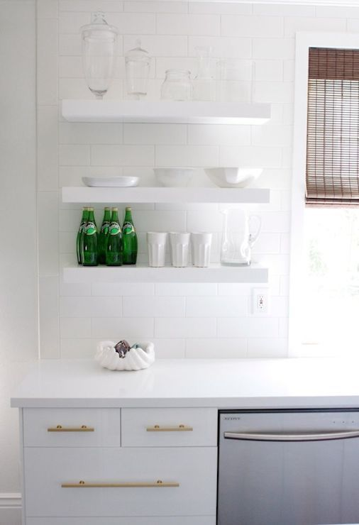 Beautiful Kitchen Features Stacked Floating Shelves Over White Lacquer  Cabinets Accented With Brass Pulls Paired With White Quartz Countertops And  White ...