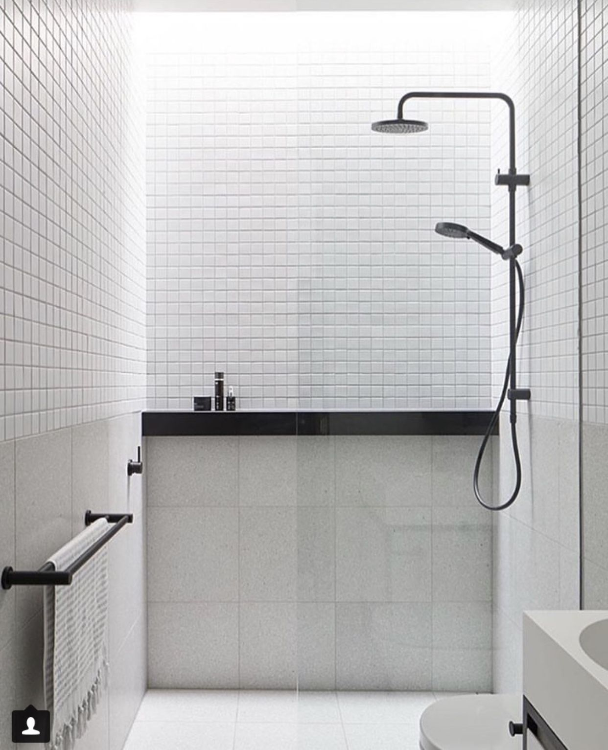 White bathroom with low level large light grey tiles and high mosaic black fixtures beautiful minimal also was plas pinterest taps minimalist