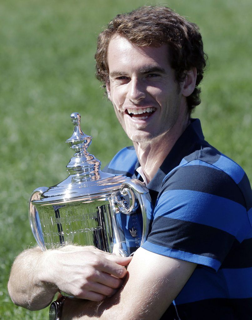 Andy Murray holding tight to his US Open trophy, 11 September 2012