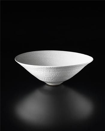 Lucie Rie, large conical bowl, Stoneware, pitted pure white glaze. 5 1/2 in (14.1 cm) high, 14 7/8 in (38 cm) diameter, 1972