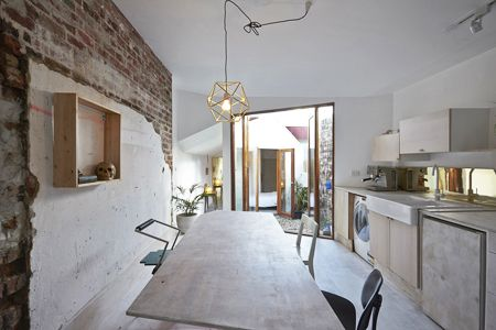 Smallest house on the street, renovation of a workers cottage in Fitzroy, Australia. Retaining the existing street frontage and primary living areas whilst fragmenting the building addition beyond. Creating courtyards which serve to separate yet connect the functions for living. A collection of raw and untreated finishes creating a grit that compliments the owners desire for an uncomplicated living arrangement.