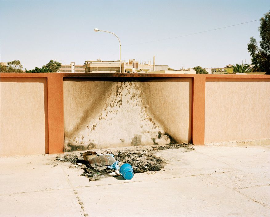 Magnum Photos -  Tim Hetherington LIBYA. Adjdabyia. Around 6th of April 2011. The remnants of a fire that burnt medical waste, at the back entrance to the Adjdabya Hospital Morgue.