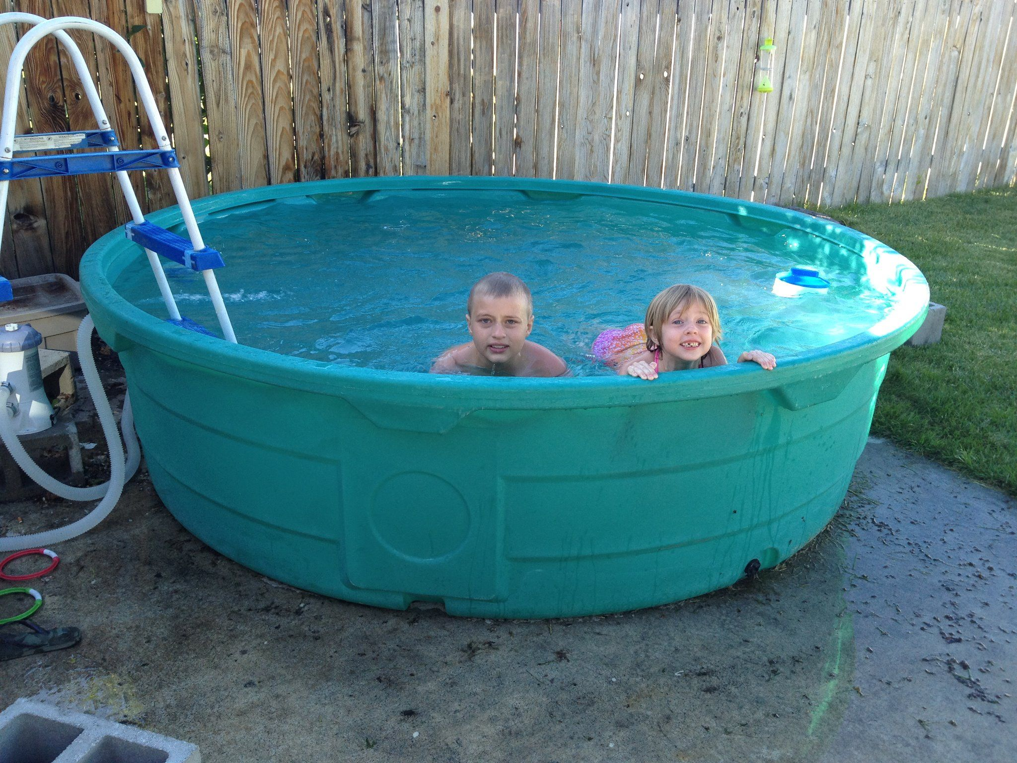 Montana Swimming Pool 920 Gallon Stock Tank Bought At Murdoch S In Missoula Cute Grandkids Not Included Stock Tank Pool Stock Tank Swimming Pool Tank Pool