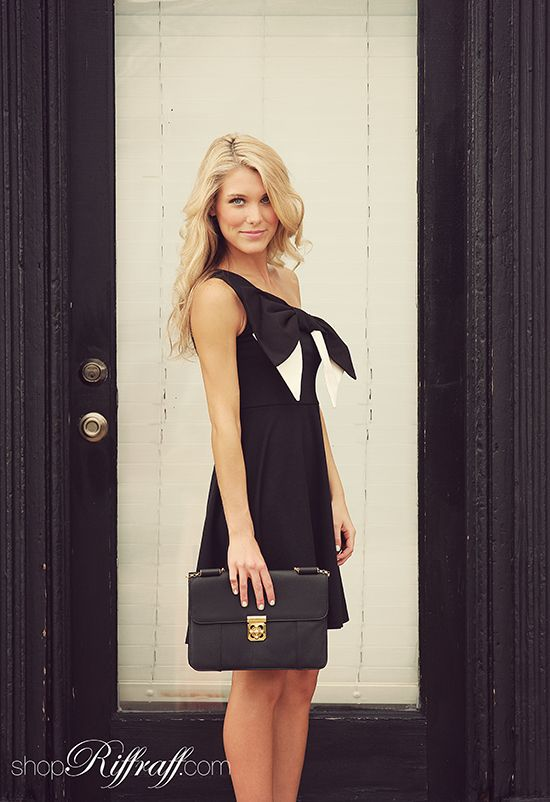 BOW TIE Today's look features our twist on the classic bow tie. We love the sharp black and white of this dress, and the perfectly oversized bow on the front! Next time your man reaches for his suit and bow tie, reach for this dress to match... get it today on www.shopriffraff.com!  {clutch available in store, call to order, 479-571-4000}