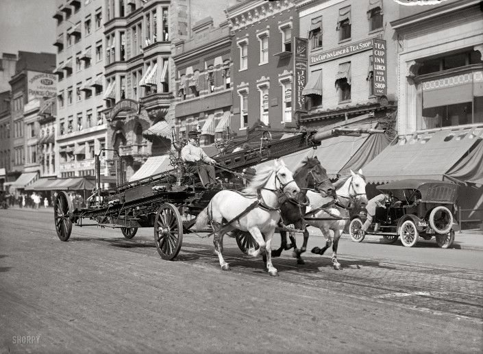 Washington, D.C., circa 1914. Three-horse team pulling water tower.