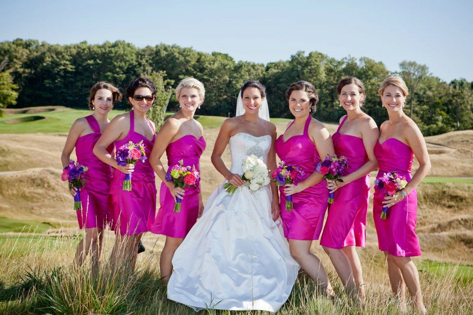 Pink bridesmaid dresses with bright colorful bouquets.