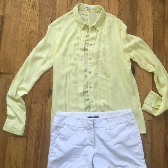 Yellow and white pin stripes button down This light weight button down is perfect for spring! I absolutely love this shirt, just never fit me right. I wore it twice. The Hanger brand can be found a select boutiques, and on line. the Hanger Tops Button Down Shirts
