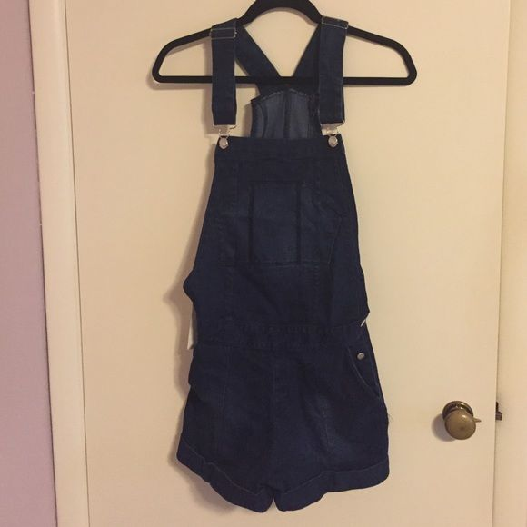 Dark Wash Short Overalls Super cute and perfect with tights! Unfortunately they run very small and do not fit me. The tag says large but I'd say they would fit a small best. Comes in the original bag. Feel free to make a reasonable offer or ask any questions! Haoduoyi Other