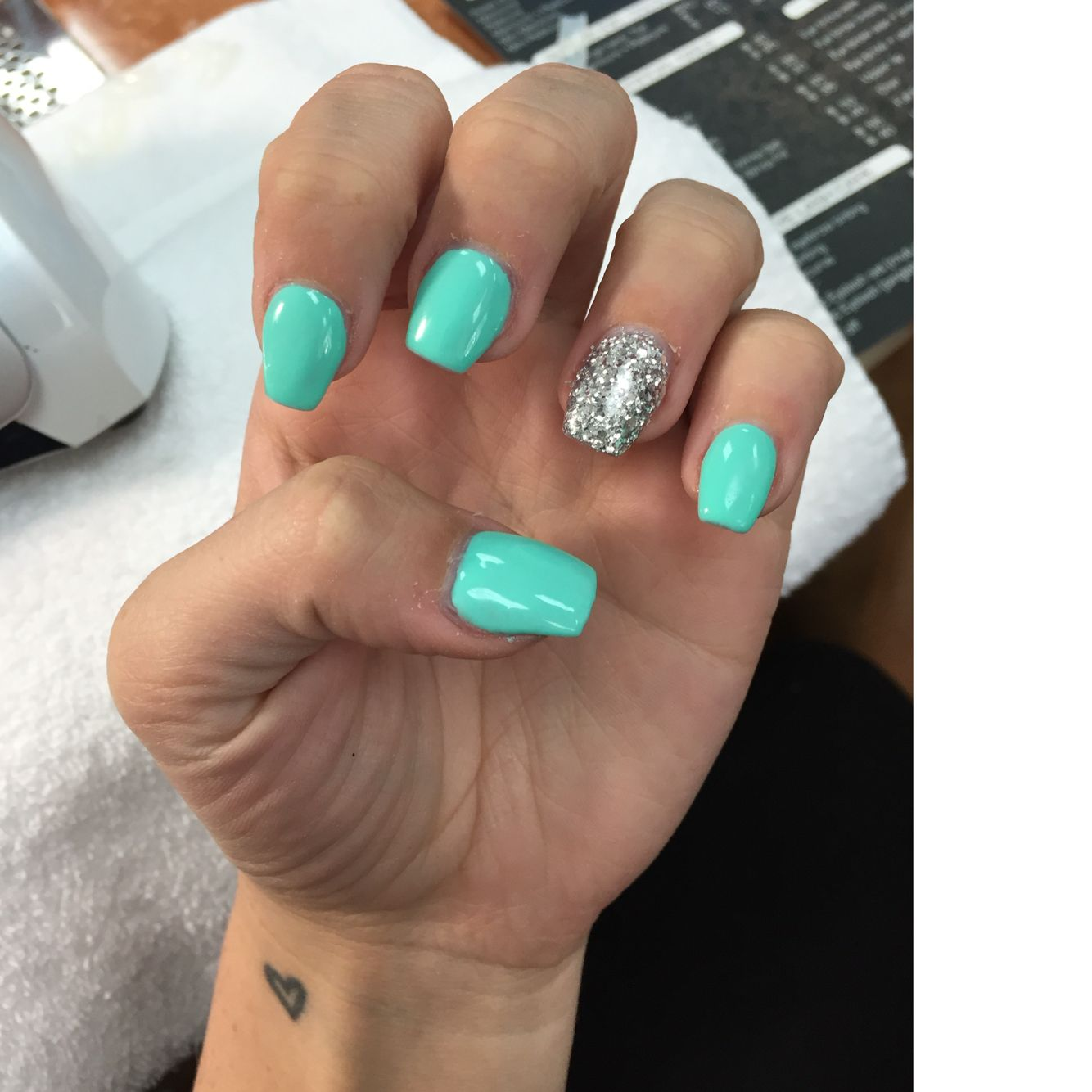 Tiffany blue and silver nails. Done at Starlit nails. Solar powder ...