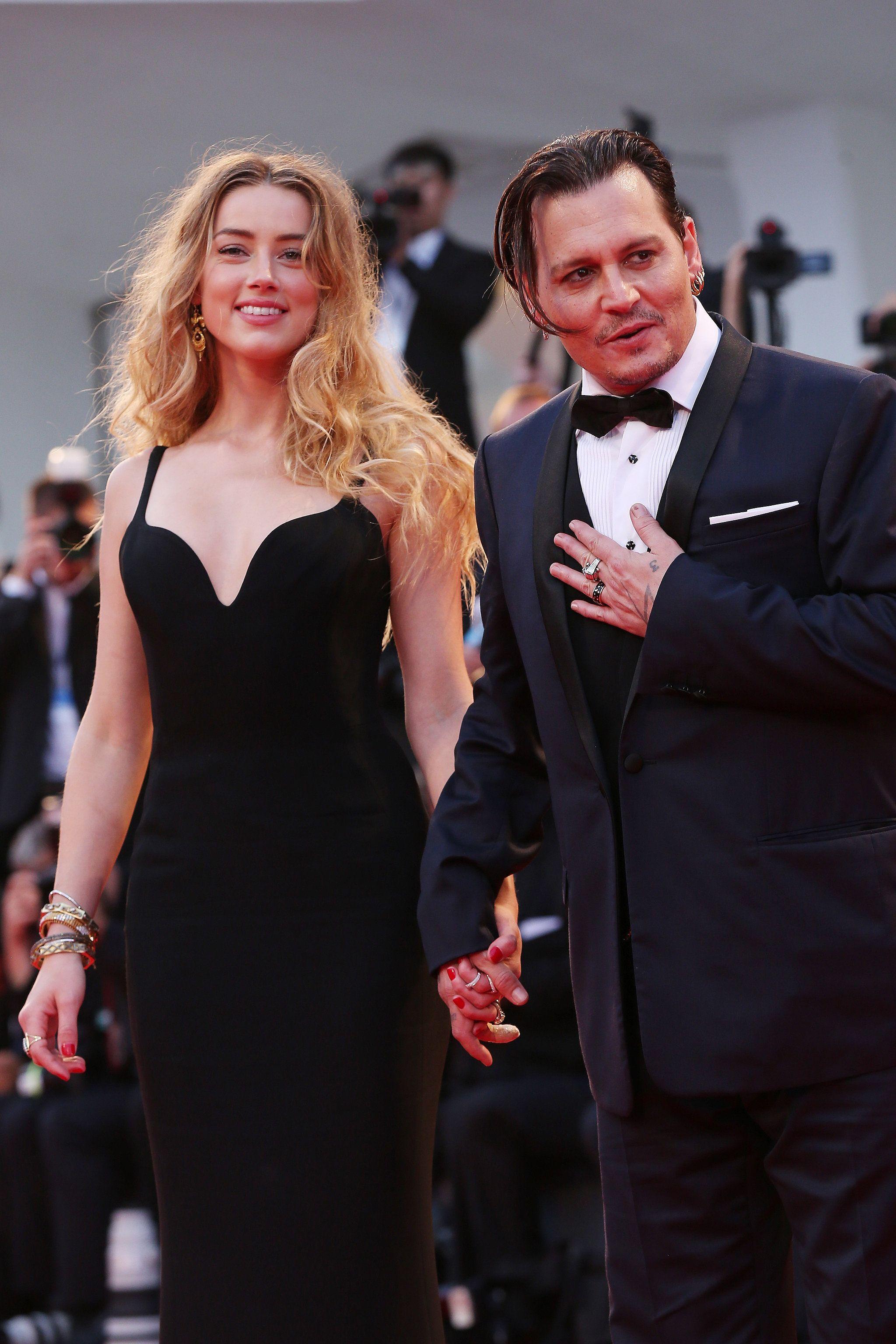 Johnny Depp And Amber Heard Share The Look Of Love On The Red Carpet Johnny Depp And Amber Johnny Depp Amber Heard