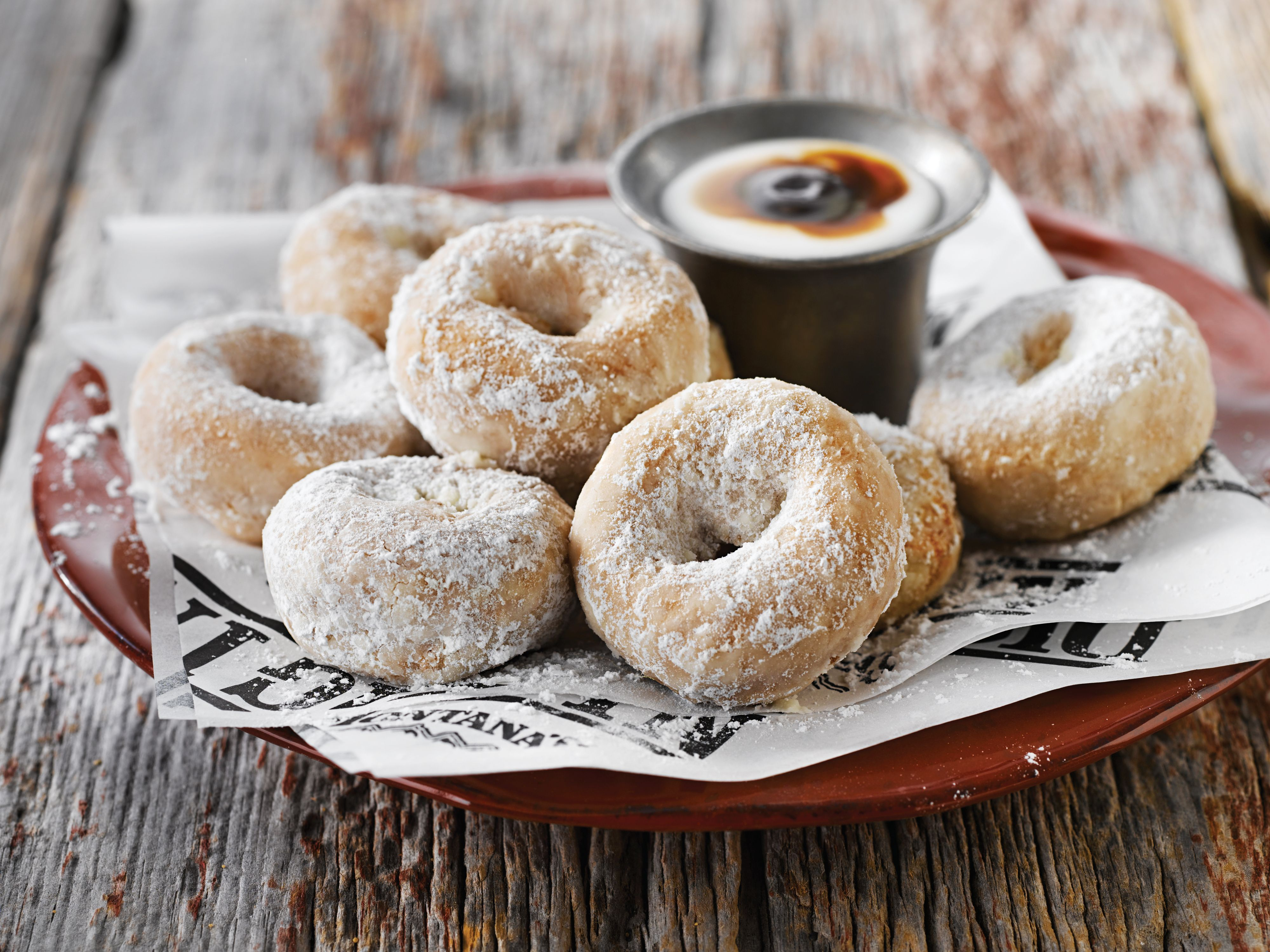 Shake N Share Mini Donuts  - eight warm mini donuts made fresh to order and tossed in powered sugar served with white chocolate cinnamon sauce