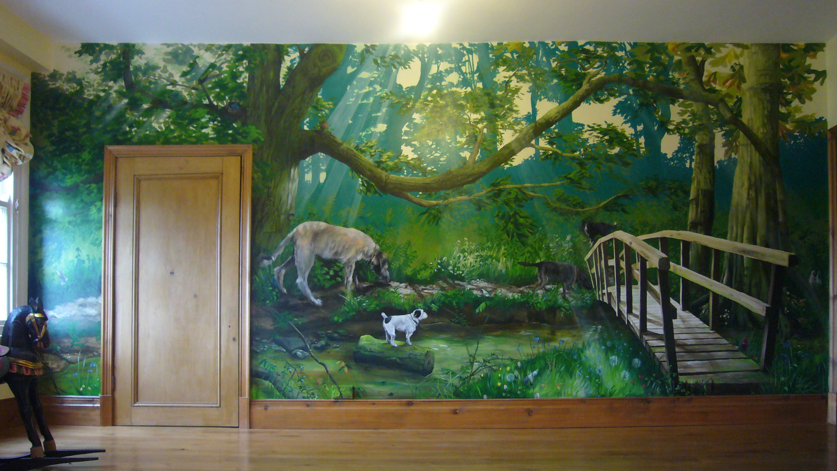 A hand painted forest mural on a child s bedroom wall showing