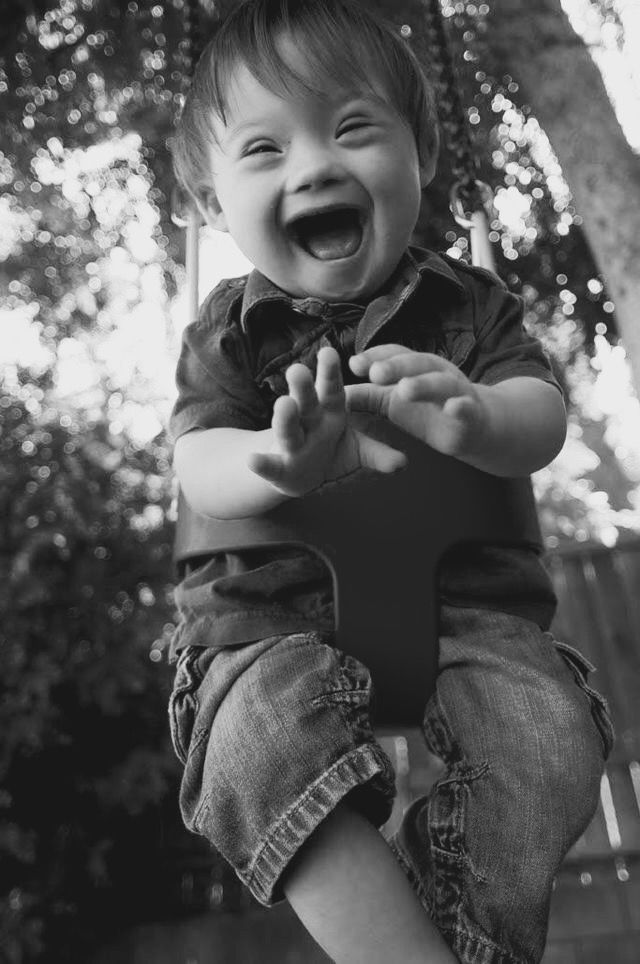 So in love with swinging...you can almost hear his belly laugh!