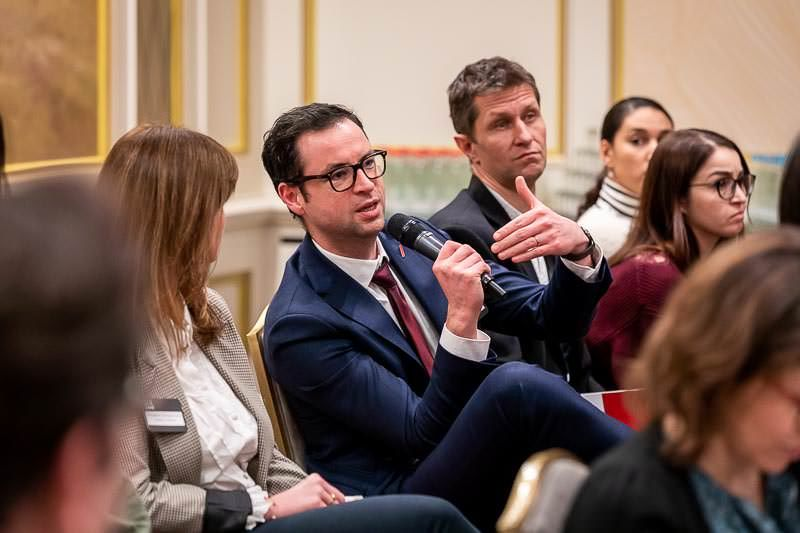 A man asks a question to the members of the discussion panel during the GC Summit Belgium 2020 Conference at the Steigenberger Wiltcher's in Brussels. Conference photography by Dani Oshi.   #danioshi #brussels #canonphotography #corporate #corporateevents #events #brusselsevent #eventphotographer #eventphotography #gcsummit #conference #legal #lawyers #question #QA #askingquestion
