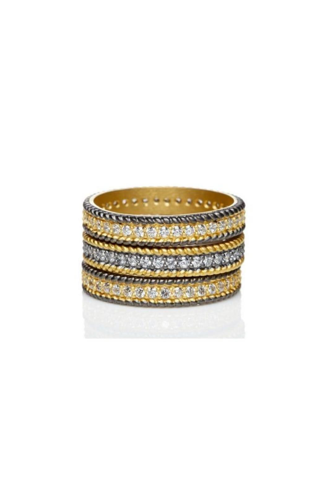 3 separate stackable Sterling Silver with 14k yellow gold and black Ruthenium.Each ring is set with hand-cut white cubic zirconias that wrap around the entire band. Since each ring is separate the possibilities are endless!  Pave Eternity Stackers by Freida Rothman . Accessories - Jewelry - Rings New York