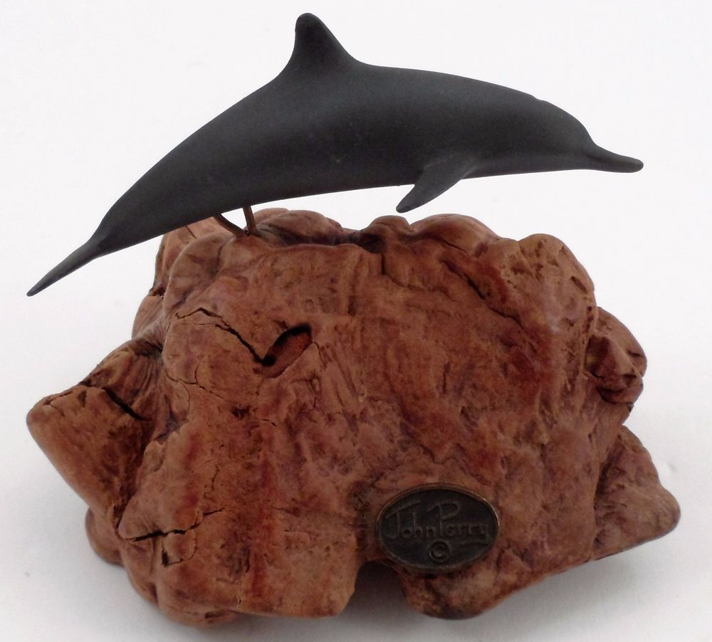 John perry grey swimming dolphin sculpture on burl wood