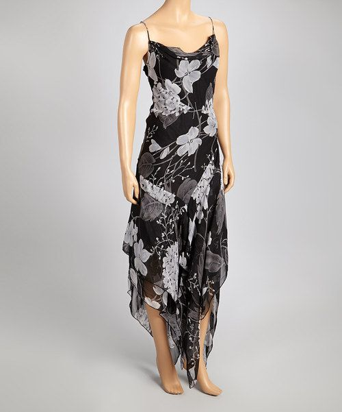 A fabulous floral finish combines with contrasting shades of black and white to craft a sleeveless silhouette that moves with sinuous grace along the hemline.Measurements (size M): 62'' long from center back neckline to hem100% rayonHand wash; hang dryImported