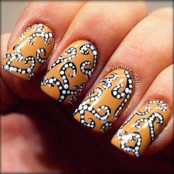 black and white dotted swirls nail