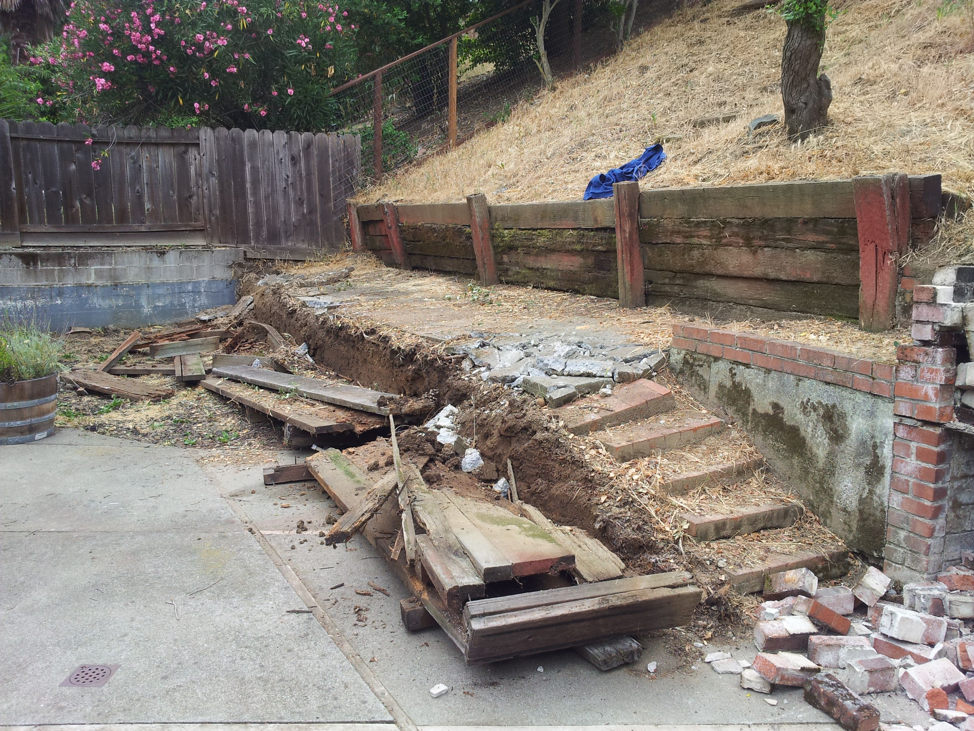 Removing Old Wood Retaining Wall Replacing With Mcnear Versa Lok Retaining Wall Www Allaccesslandscape Co Retaining Wall Real Estate Client Wood Retaining Wall
