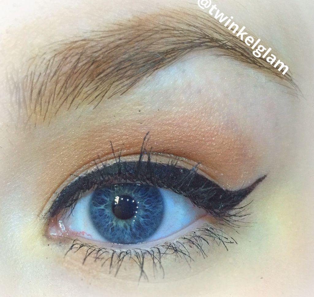 Bold winged eyeliner with soft crease