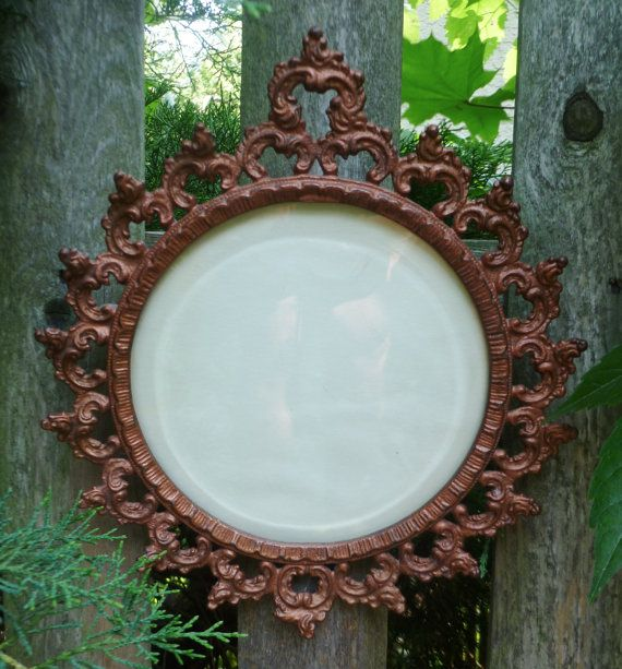 A beautiful Victorian cast iron picture frame. Or replace the glass with mirror.