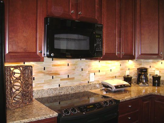 Finished our backsplash Tan Brown granite dark cherry cabinets