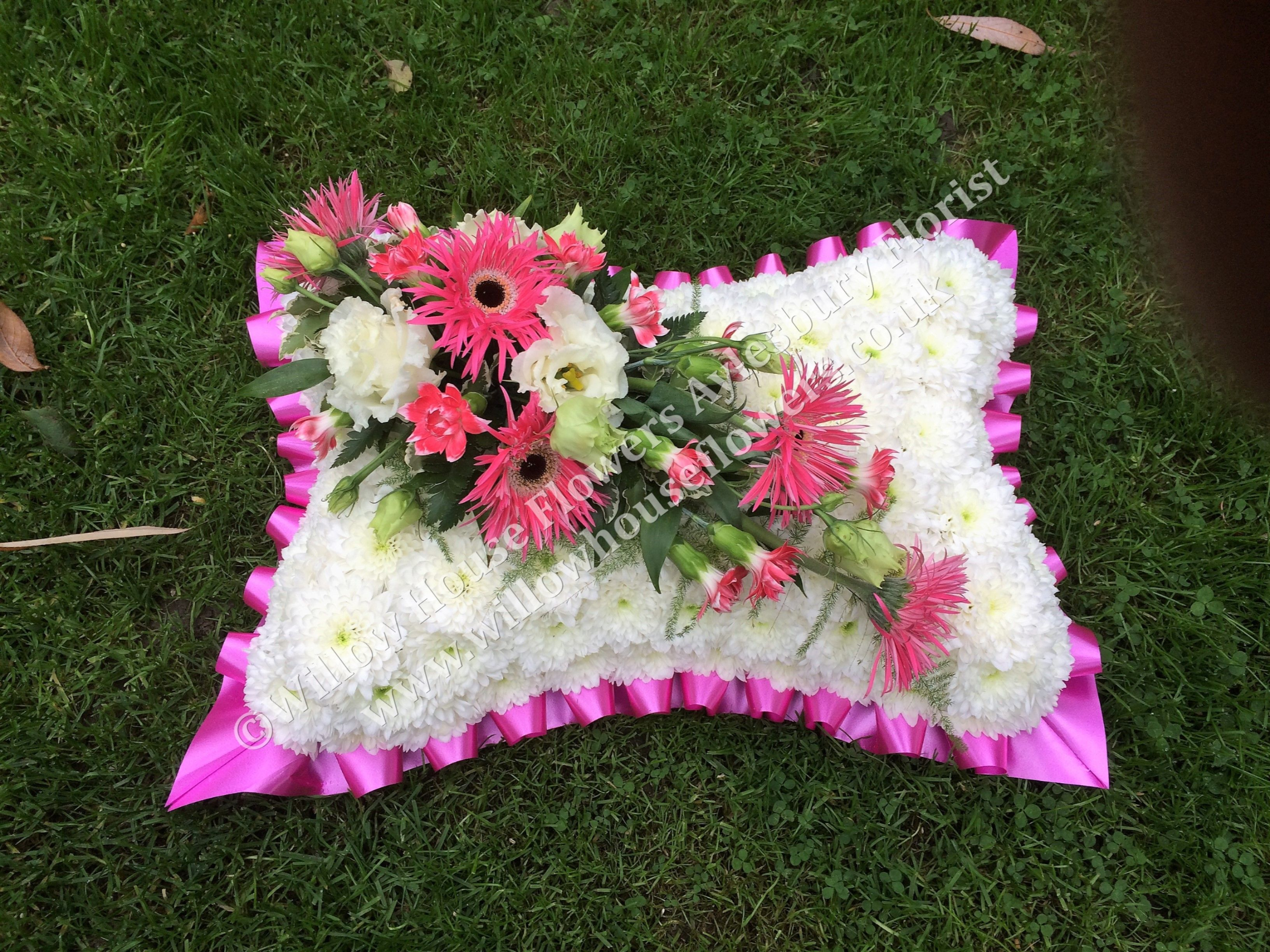 traditional funeral pillow wreath tribute available in a