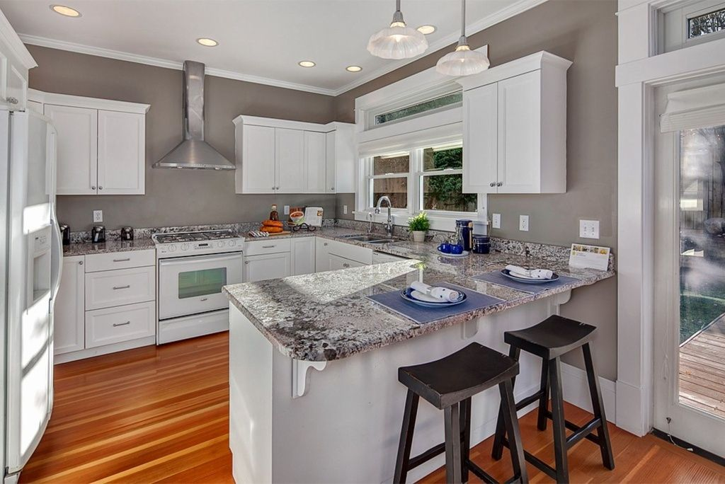 Contemporary Kitchen with Ushaped, Pendant light, Transom