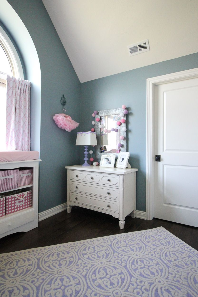A Shared Little Girls Bedroom With Pink Purple And Teal Living