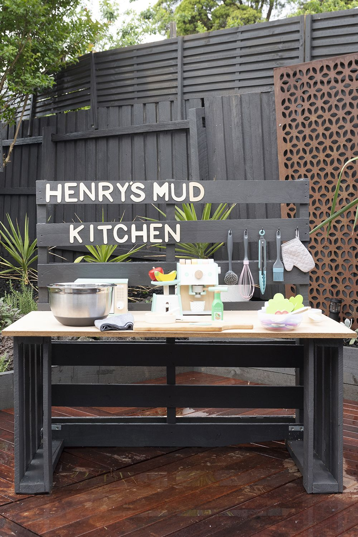 A mud kitchen is an outdoor pretend play kitchen that