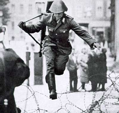 Photo of Conrad Schumman, a guard during the building of the Berlin wall, defected on it'…