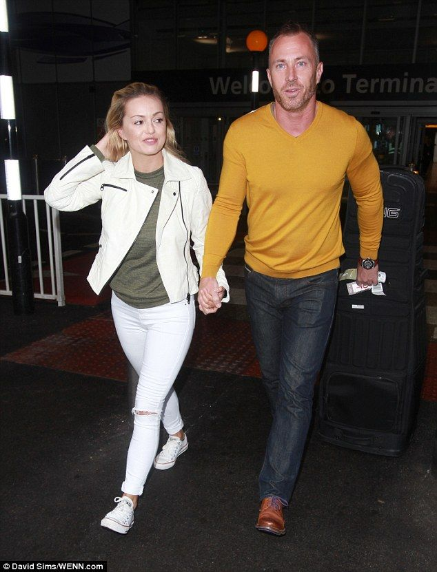 Tan-tastic!Clad in a mustard coloured jumper, James also seemed to have caught the Australian sun as he sported a deep tan whilst strolling through the terminal with his wife