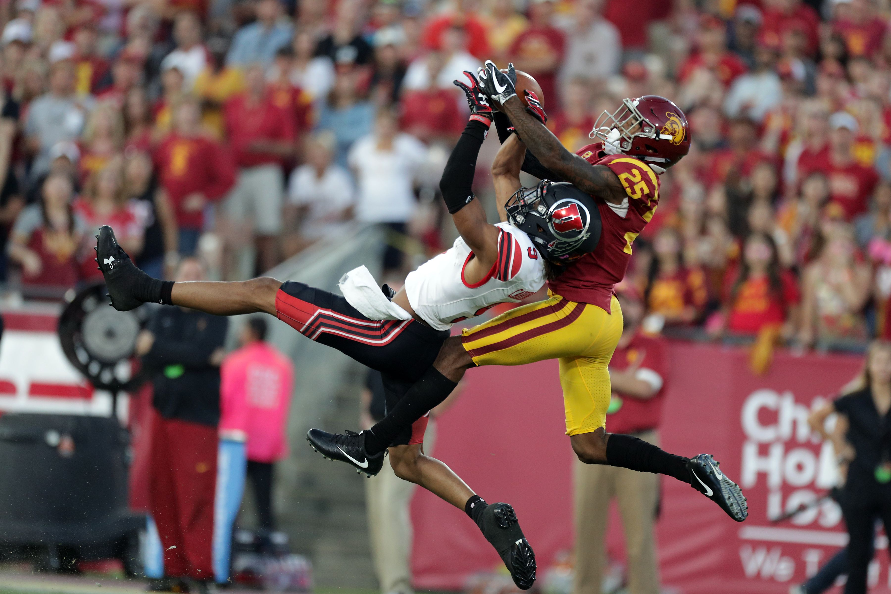 A Utah Football Safety breaks up a pass against USC