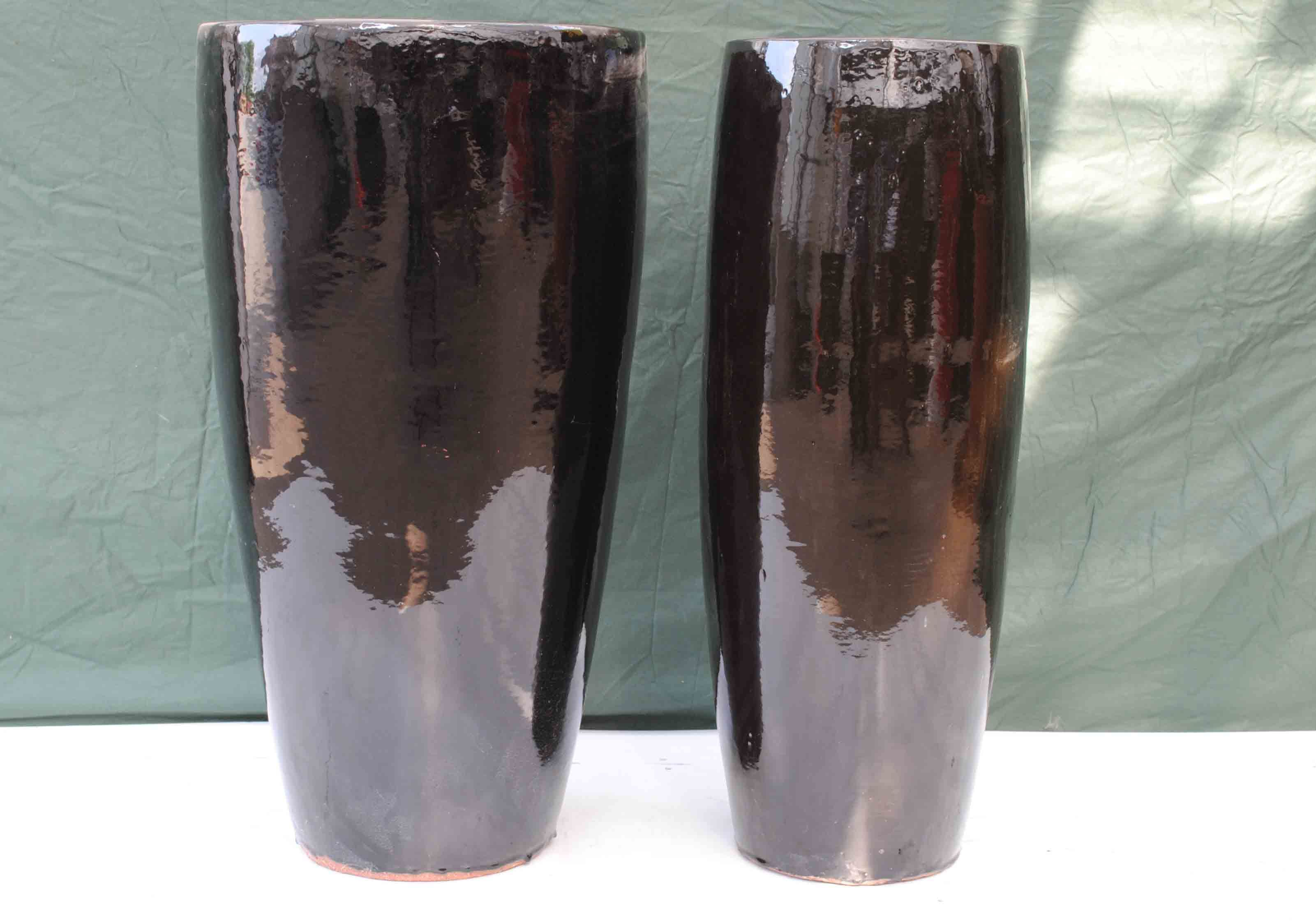 2 Non Matching Black Ceramic Planters Perfect Condition Both 87cm Tall 31cm And 45cm Dia At The Top