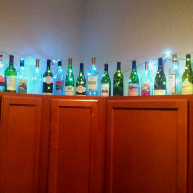 Lights inside wine bottles- cute setup in my neighbors kitchen!