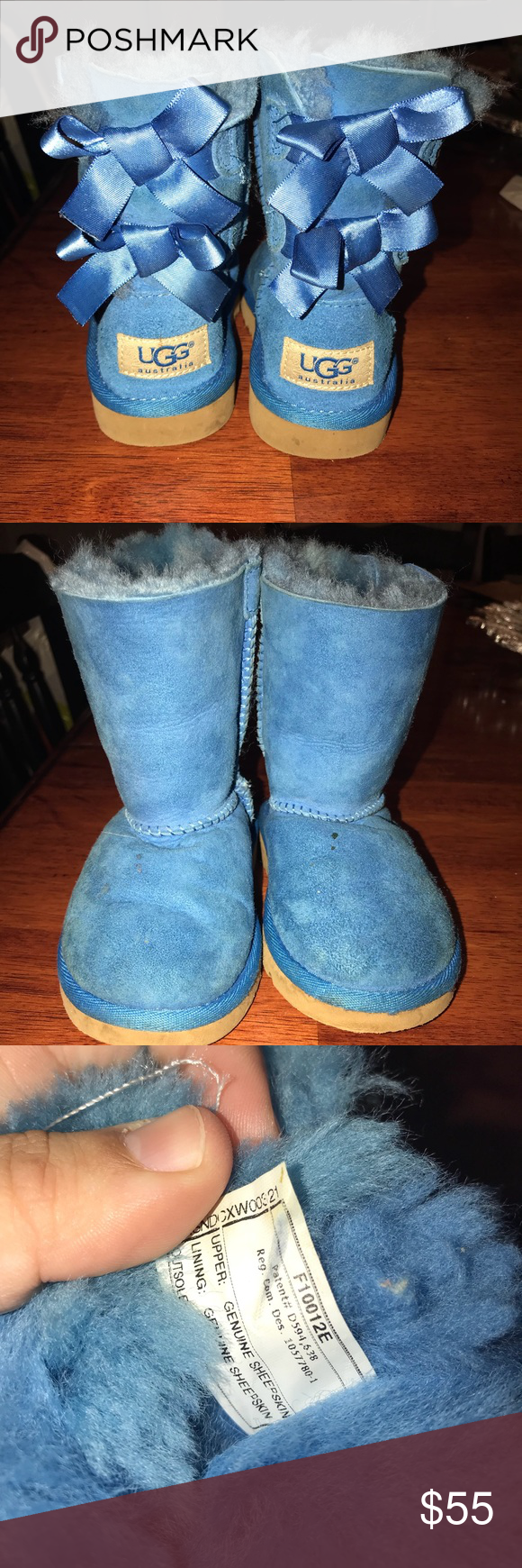 Girls Bailey Bow Blue Uggs Size 7 US children's Ugg boots with adorable bows. Slight wear and a few small stains on front top of boots, see pictures.