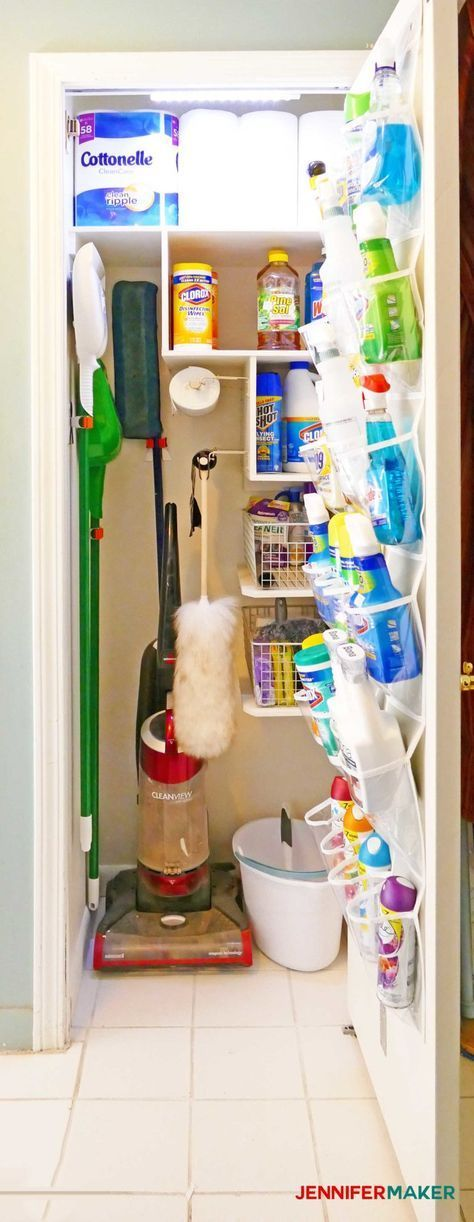 A well stocked and organized cleaning closet with light door holder bag holders and broom holders #closet #closet #makeover